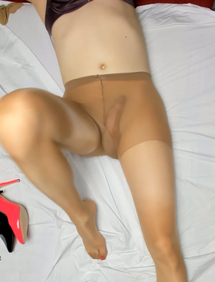 Sissy in Pantyhose shows her hard cock in pantyhose